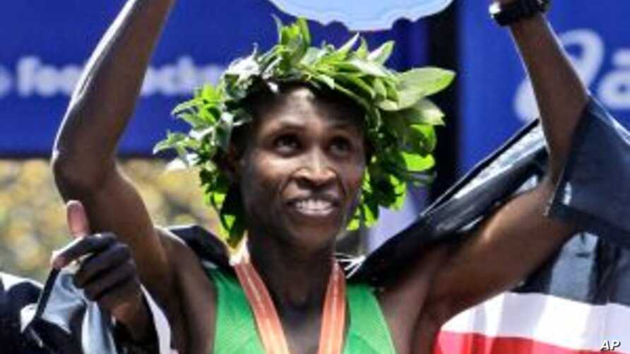 Geoffrey Mutai, of Kenya, holds his trophy after winning the men's division of the New York City Marathon in New York, November 6, 2011.