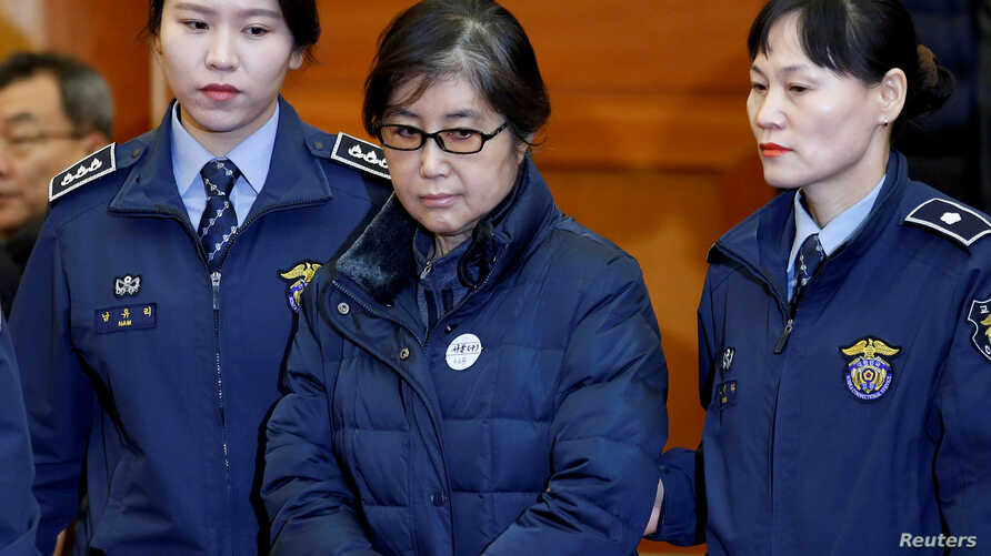 FILE - Choi Soon-sil, the woman at the centre of the South Korean political scandal and long-time friend of President Park Geun-hye, arrives for a hearing arguments for South Korean President Park Geun-hye's impeachment trial at the Constitutional Co...