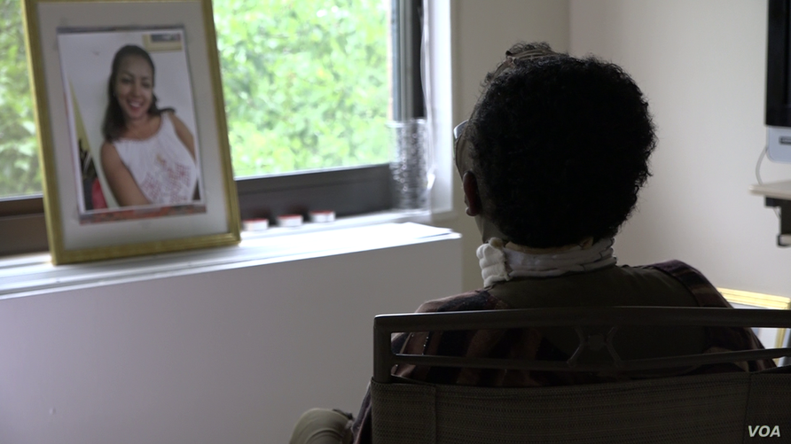 Selamawit Tefera sits by a windowin this still frame from