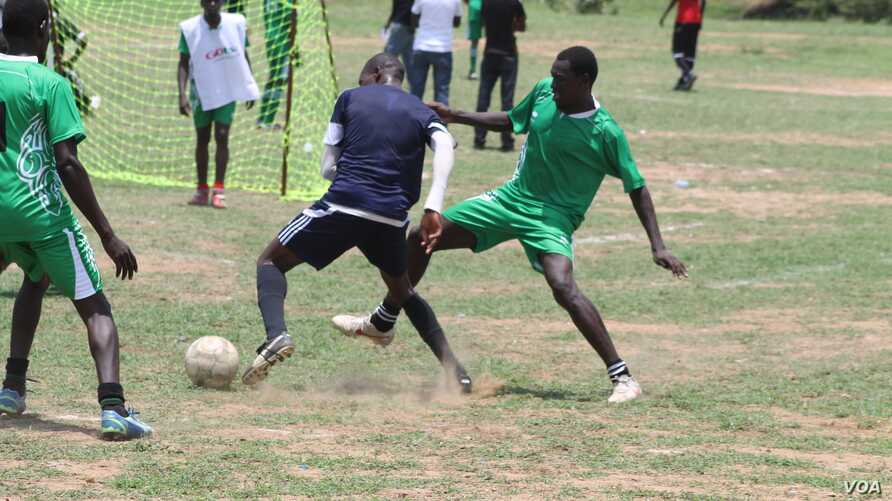 Players battle for possession of the ball at the inaugural Corporate League, which aims to bring South Sudanese together so that they can forge friendships and promote peace.