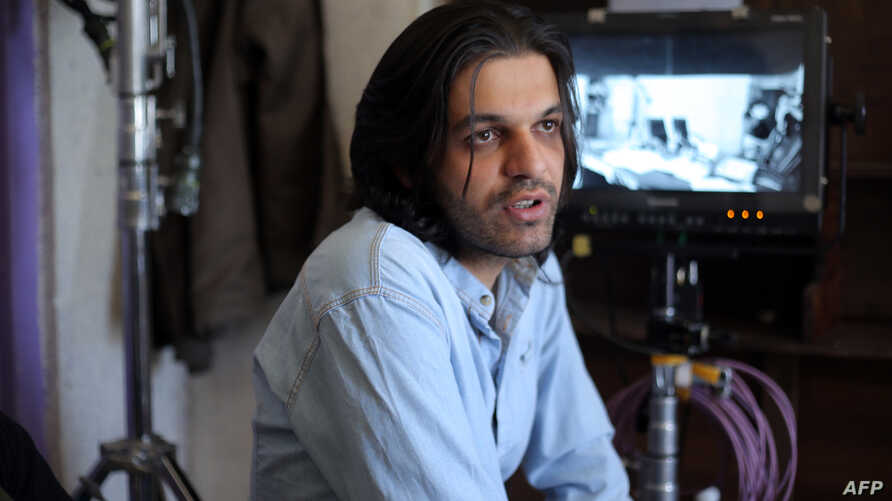 """An undated photo provided by Iranian filmmaker Keywan Karimi, shows Karimi during work on a scene in the movie """"Drum"""", in Tehran early in 2016."""