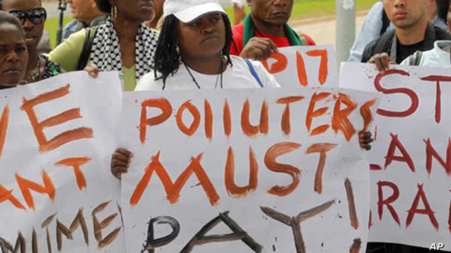 Environmental activists demonstrate outside the United Nations Framework Convention on Climate Change Conference of the Parties meeting in Durban, November 29, 2011.