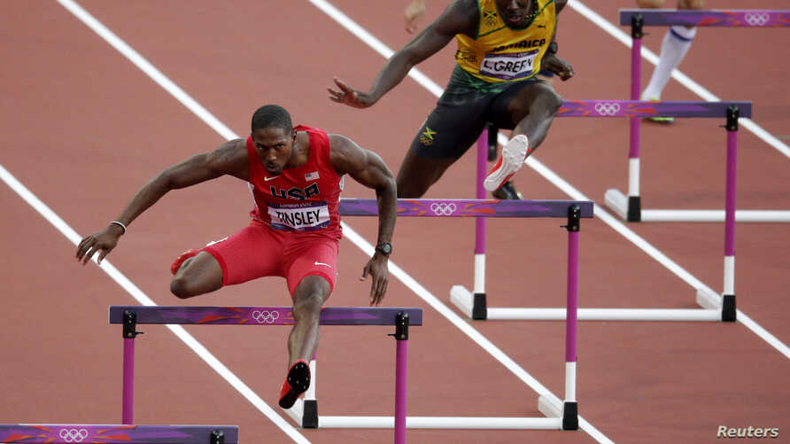 Michael Tinsley of the U.S. (L) and Jamaica's Leford Green clear hurdles during the men's 400m hurdles semi-finals at the London 2012 Olympic Games