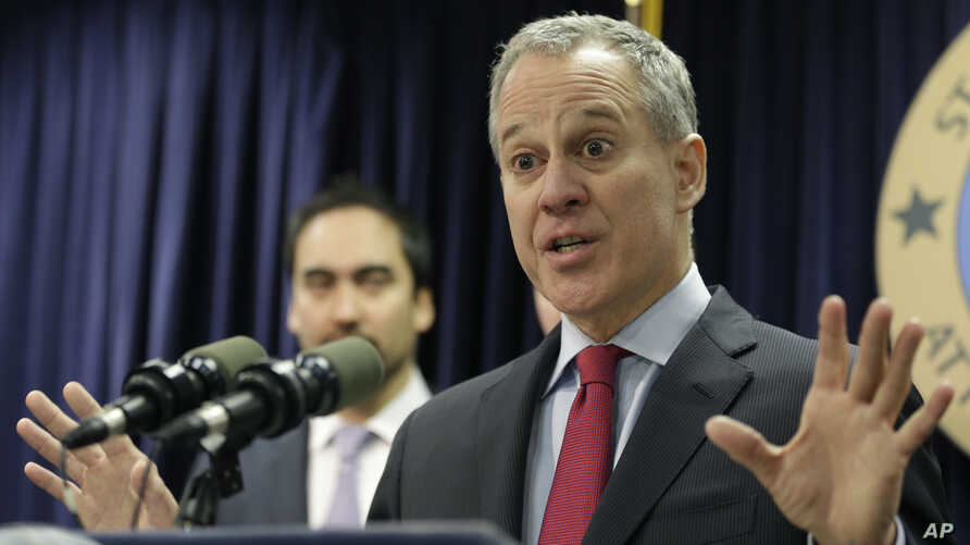 FILE - Two weeks after officials in two dozen states asked Donald Trump to kill one of President Barack Obama's plans to curb global warming, New York Attorney General Eric Schneiderman was the lead author on a rebuttal letter signed by Democratic at