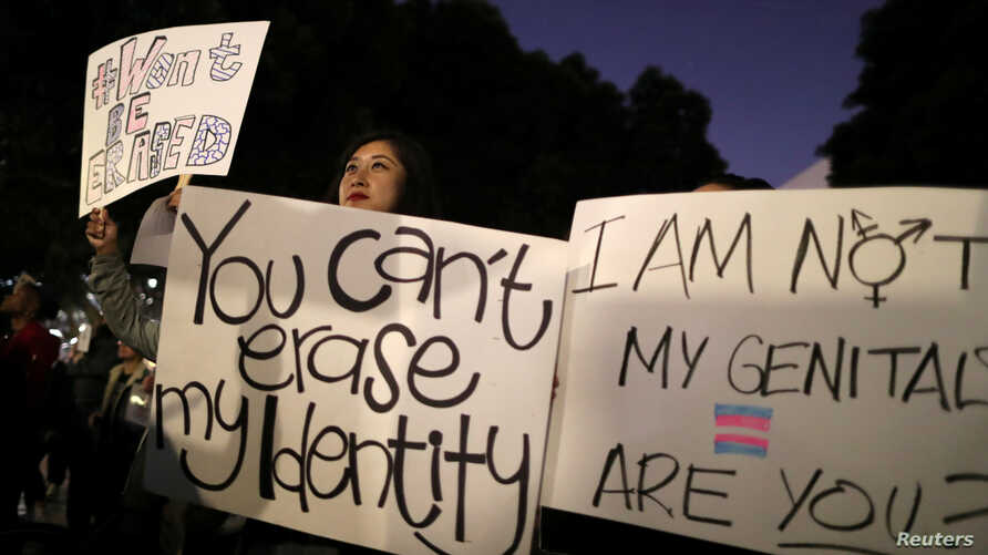 People rally to protest the Trump administration's reported transgender proposal to narrow the definition of gender to male or female at birth, in Los Angeles, California, United States, October 22, 2018.