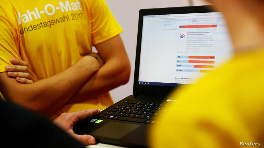 A laptop displays results on a Wahl-O-Mat webpage in Berlin, Germany, Aug. 30, 2017. The online tool helps German voters choose a party for upcoming general elections.