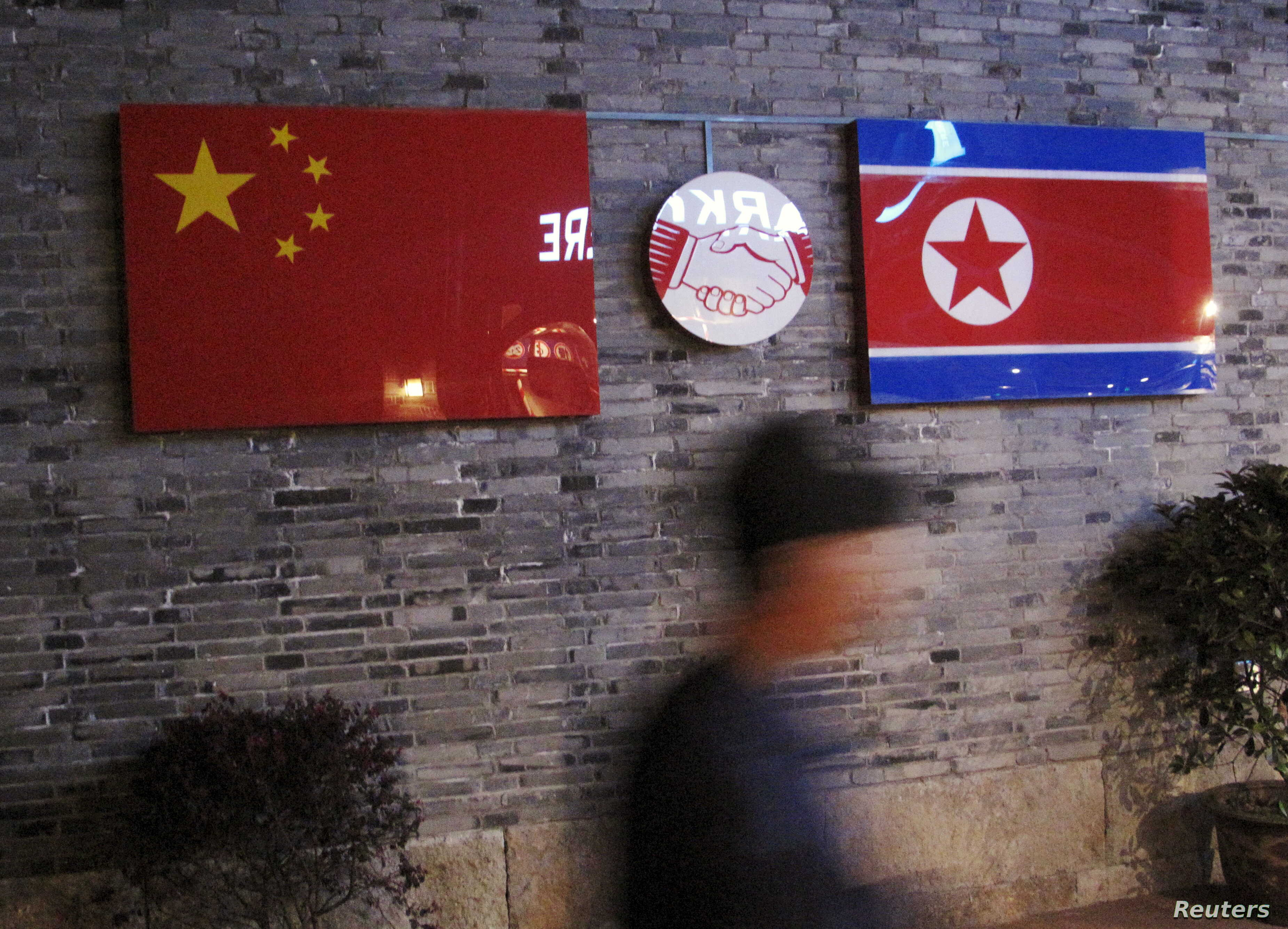 FILE - Flags of China and North Korea are seen outside the closed Ryugyong Korean Restaurant in Ningbo, Zhejiang province, China, April 12, 2016.