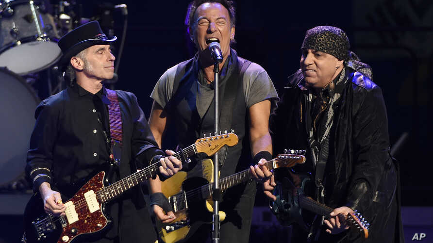 FILE - Bruce Springsteen, center, performs with Nils Lofgren, left, and Steven Van Zandt of the E Street Band during their concert at the Los Angeles Sports Arena in Los Angeles, March 15, 2016. The band's Sept. 7 concert in Philadelphia topped four