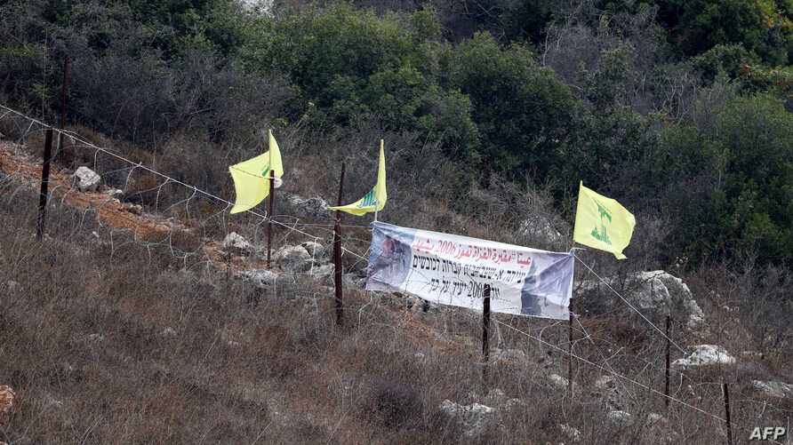 "Hezbollah's flags fly at ""Point 105"" on the Israel-Lebanon border, Aug. 2, 2018."