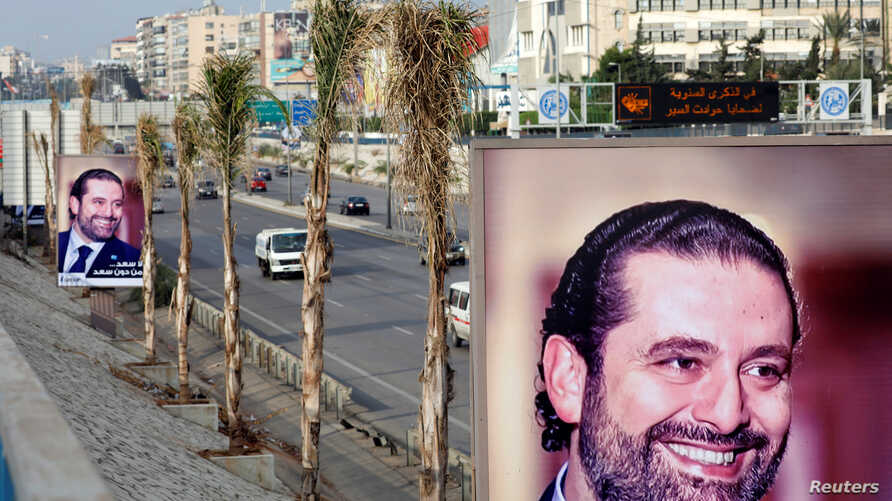 Posters depicting Saad al-Hariri, who announced his resignation as Lebanon's prime minister from Saudi Arabia, is seen at airport high way in Beirut, Lebanon, Nov. 19, 2017.
