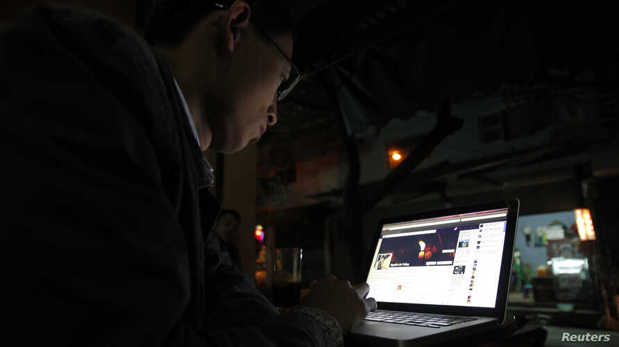 Police in Vietnam recently have detailed two prominent bloggers for criticizing the Communist government on social media.