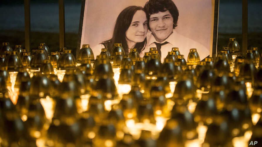 Light tributes are placed during a silent protest in memory of murdered journalist Jan Kuciak and his girlfriend, Martina Kusnirova, seen in the photograph, in Bratislava, Slovakia, Feb. 28, 2018.