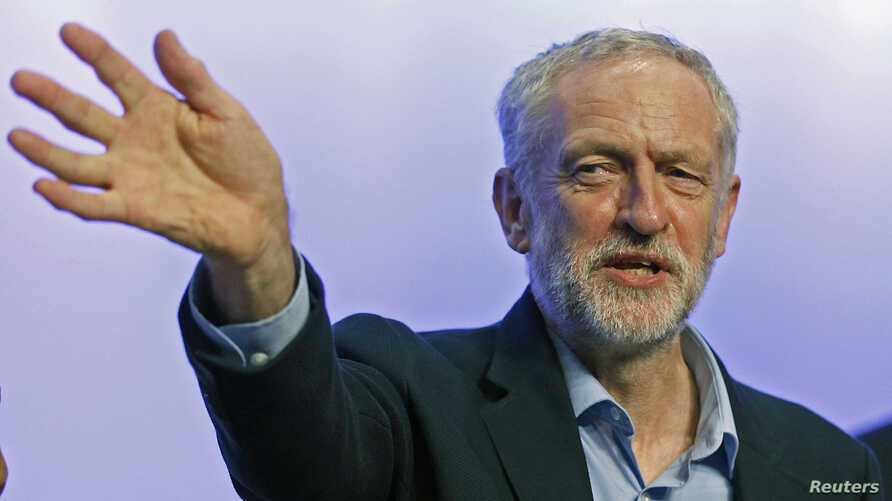 The new leader of Britain's opposition Labor Party Jeremy Corbyn waves as he acknowledges applause before addressing the Trade Union Congress in Brighton, England, Sept. 15, 2015.