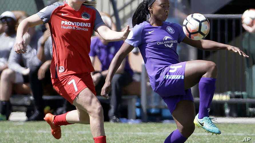 Orlando Pride forward Jamia Fields, right, controls the ball as Portland Thorns midfielder Lindsey Horan defends during the first half of an NWSL soccer match in Portland, Oregon, April 15, 2017.