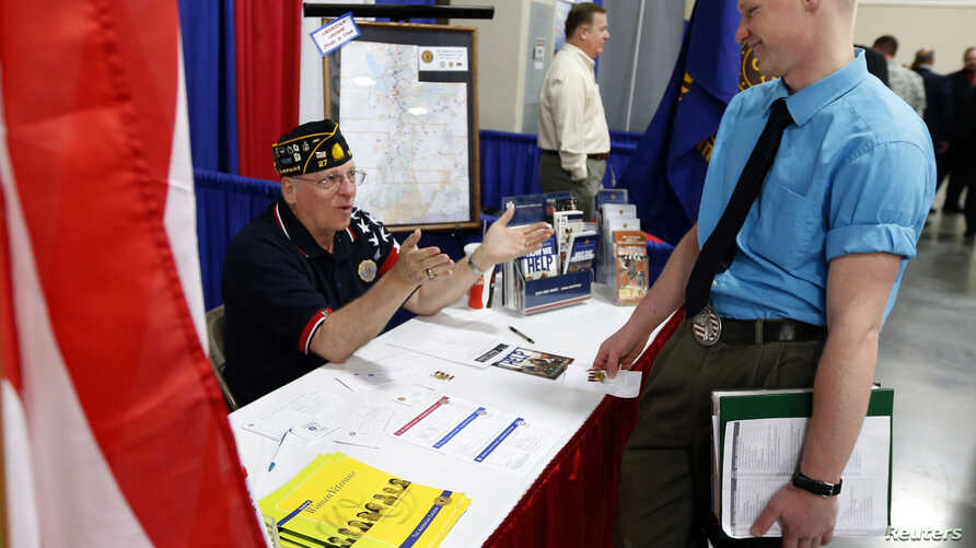 "A U.S. veteran gets information at the Veterans Administration booth at the ""Hire Our Heroes"" Job fair in Sandy, Utah, March 25, 2014."