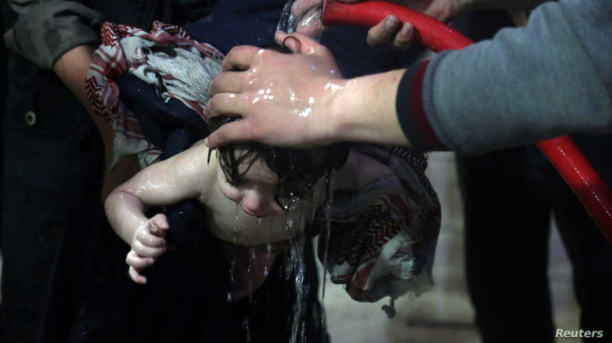 FILE - A child is treated in a hospital in Douma, eastern Ghouta in Syria, after what a Syria medical relief group claims was a suspected chemical attack April 7, 2018.