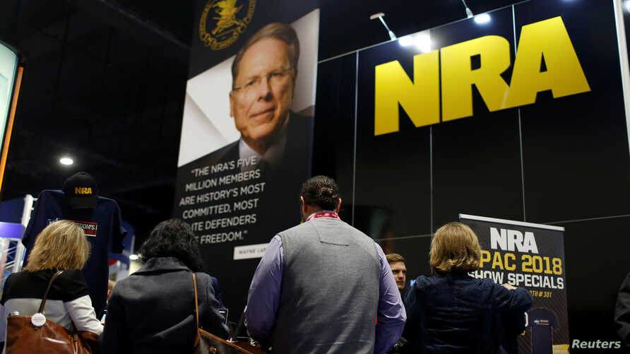 FILE - People sign up at the booth for the National Rifle Association (NRA) at the Conservative Political Action Conference (CPAC) at National Harbor, Maryland, U.S., Feb. 23, 2018.