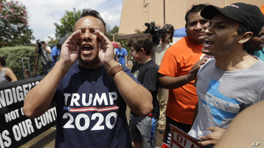 """FILE - A man who called himself a citizen taxpayer, left, argues with protesters at a a rally to oppose a new Texas """"sanctuary cities"""" bill that aligns with the president's tougher stance on illegal immigration, June 26, 2017, in San Antonio, outside"""