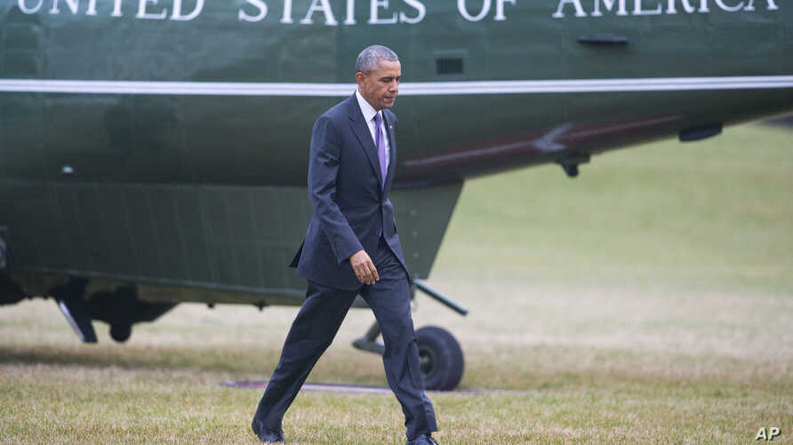 FILE - President Barack Obama walks across the South Lawn of the White House in Washington following his arrival on Marine One helicopter, March 3, 2016, from Andrew Air Force Base, Maryland.