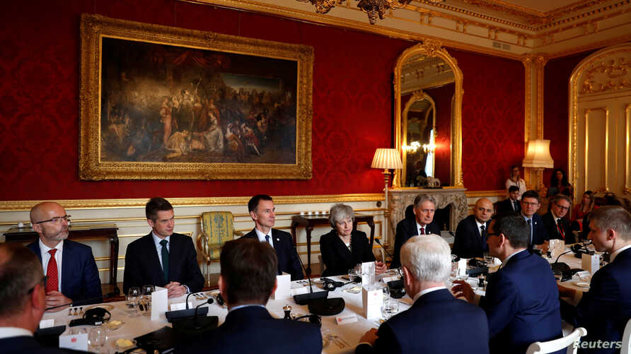 Britain's Prime Minister Theresa May sits with members of her cabinet at Lancaster House in central London, Britain, Dec. 20, 2018.
