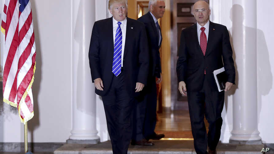 President-elect Donald Trump walks with CKE Restaurants CEO Andy Puzder from Trump National Golf Club Bedminster clubhouse in Bedminster, N.J.