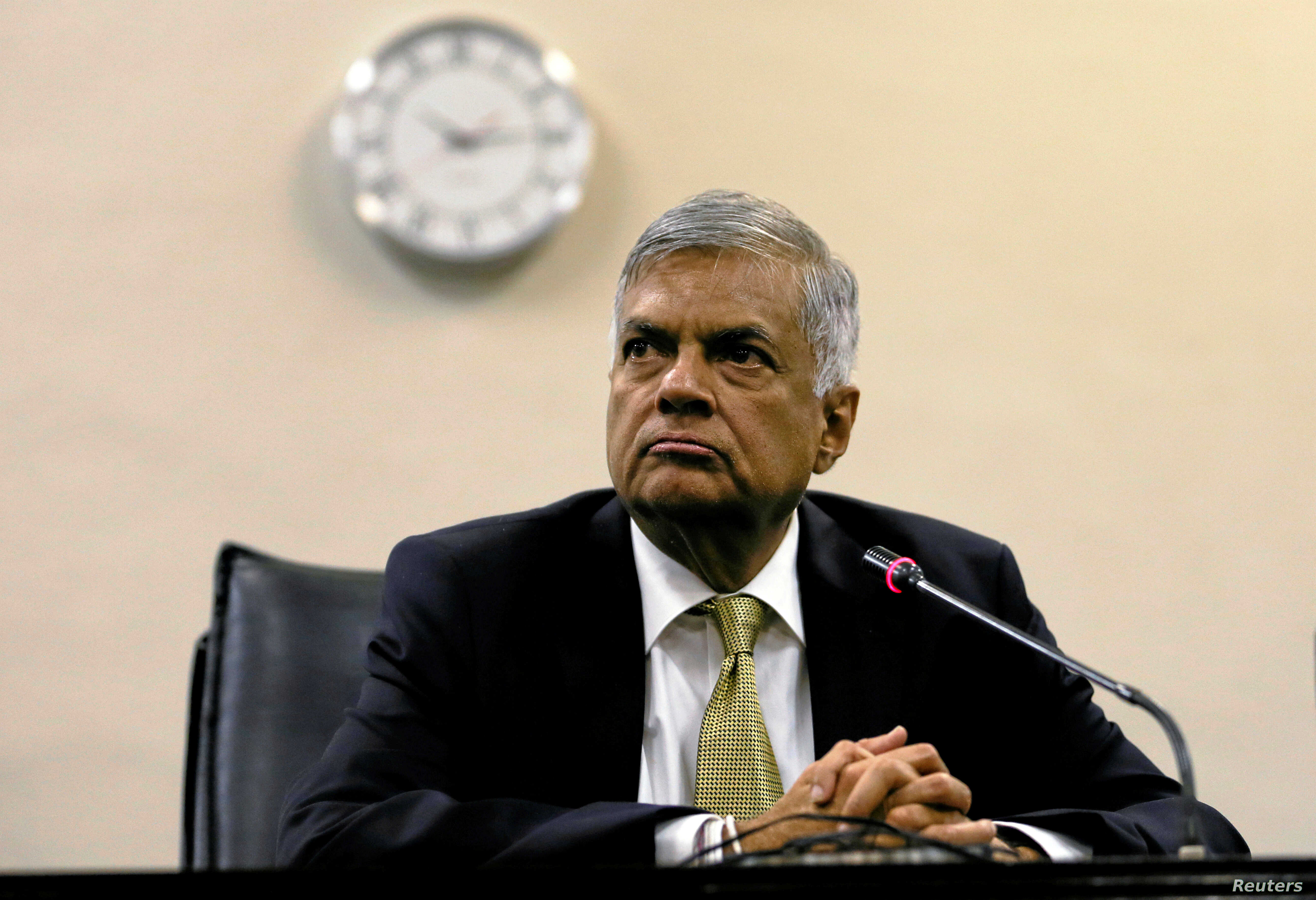 FILE - Sri Lankan Prime Minister Ranil Wickremesinghe looks on at a news conference in parliament in Colombo, Sri Lanka, April 4, 2018.