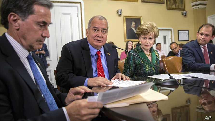 Rep. Gary Palmer, R-Ala., left, and fellow representatives and delegates work on legislation to create a financial control board for Puerto Rico and restructure some of the U.S. territory's $70 billion debt, June 8, 2016. The House later passed the l