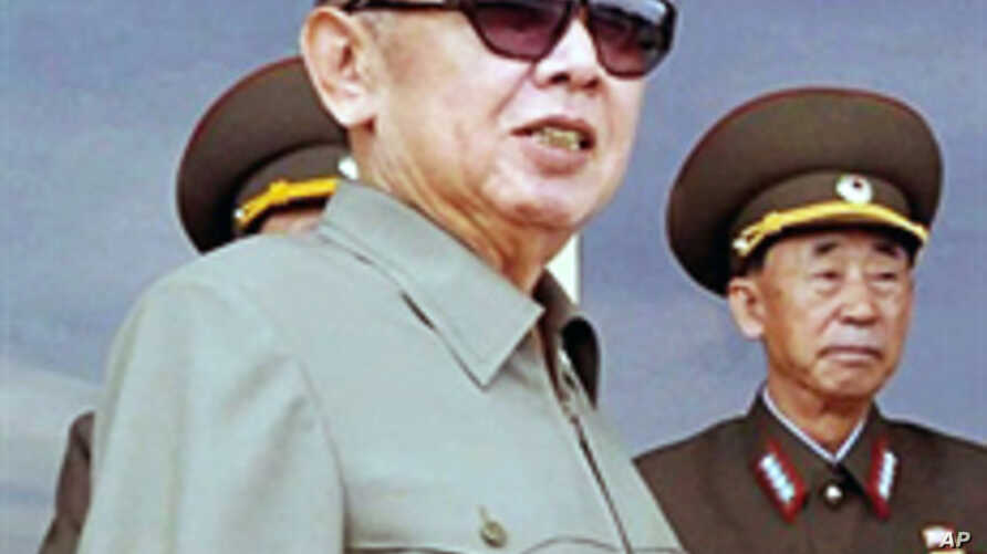 An undated file photo of N. Korean leader Kim Jong-Il (L) at undisclosed location in N. Korea