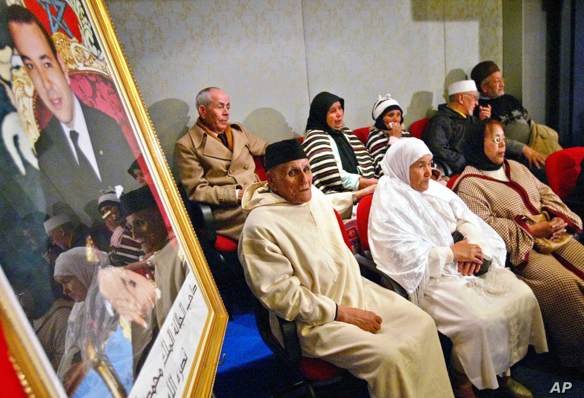 """Alleged victims of repression attend public hearings in Rabat of the Moroccan Equity and Reconciliation Commission, Dec. 21, 2004. The hearings gave victims of human rights abuses dating back decades an unprecedented platform and marking an """"importan"""