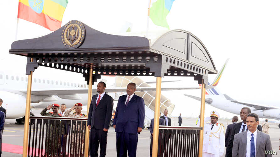 Djibouti President Ismaïl Omar Guelleh, right, welcomes Et