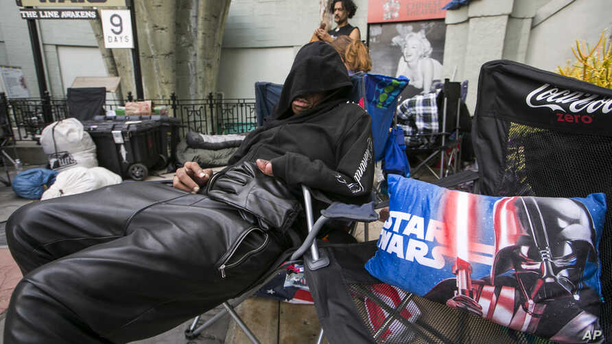 """Star Wars fan, actor Deuce Wayne from Virginia rests outside the TCL Chinese Theater Imax while waiting for the premiere of """"Star Wars: The Force Awakens"""" in Los Angeles, Dec. 9, 2015."""