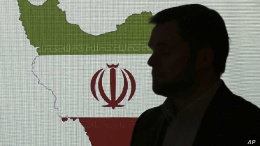 Stuart Davis, a director at one of FireEye's subsidiaries, stands in front of a map of Iran as he speaks to journalists about the techniques of Iranian hacking, Sept. 20, 2017, in Dubai, United Arab Emirates.