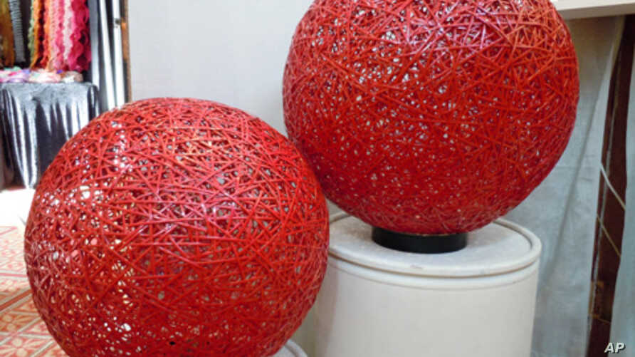 Thick, woven spheres are handcrafted from recycled street sweeper bristles by mixed media artist and repurposing advocate Aaron Kramer of Santa Monica, California.
