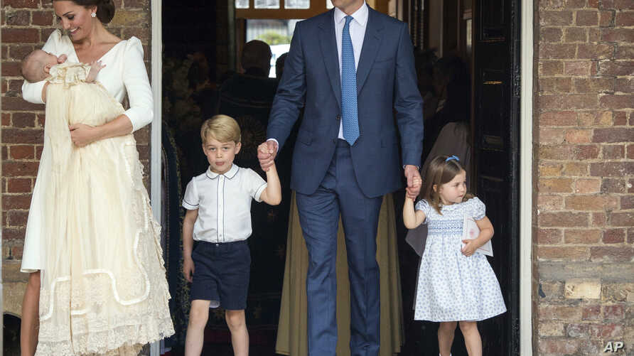 FILE - Britain's Prince William and Kate, Duchess of Cambridge with their children Prince George, Princess Charlotte Prince Louis as they arrive for Prince Louis' christening service at the Chapel Royal, St James's Palace, London, July 9, 2018.
