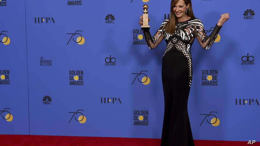 """Allison Janney poses in the press room with the award for best performance by an actress in a supporting role in any motion picture for """"I, Tonya"""" at the 75th annual Golden Globe Awards at the Beverly Hilton Hotel on Sunday, Jan. 7, 2018, in Beverly"""