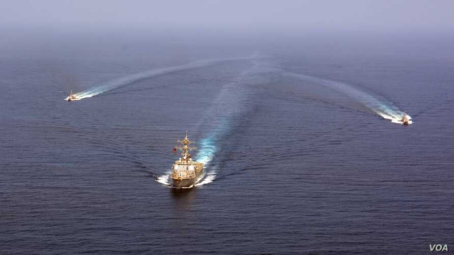 The guided-missile destroyer USS Mason (DDG 87) conducts formation exercises with the Cyclone-class patrol crafts USS Tempest (PC 2) and USS Squall (PC 7) in Arabian Sea, Sept. 10, 2016.