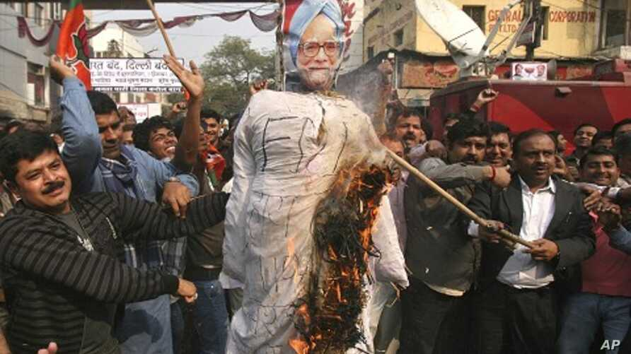 Activists from India's main opposition Bharatiya Janata Party (BJP) burn an effigy depicting India's Prime Minister Manmohan Singh during a protest against the government's decision to allow Foreign Direct Investment (FDI) in the retail sector, in Ne
