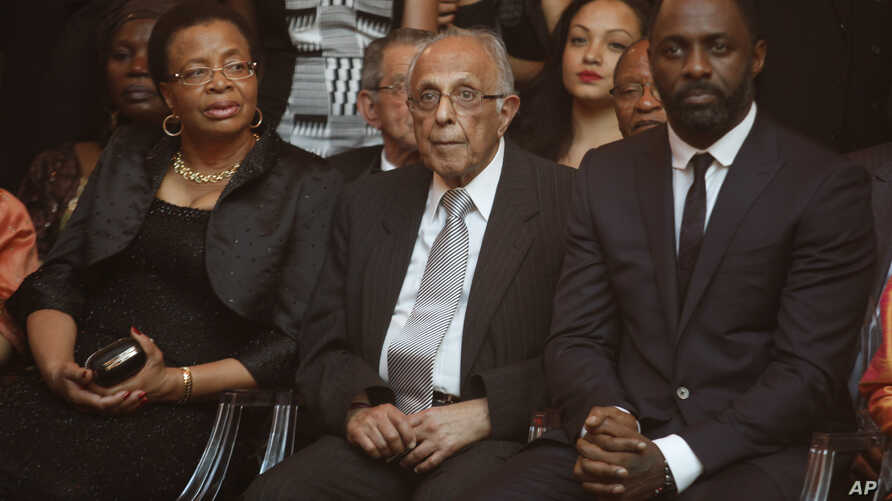 "FILE - Former political prisoner Ahmed Kathrada, center, and wife of former president Nelson Mandela, Graca Machel, left,  at the South African premier of the film ""Mandela - Long Walk To Freedom,"" in Johannesburg, Nov. 3, 2013. Actor Idris Elba, who"