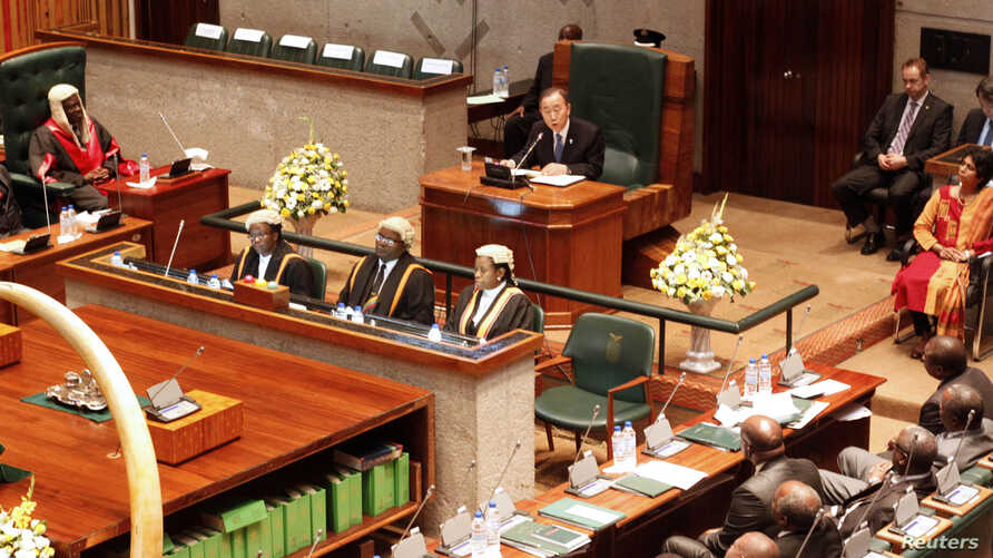 United Nations Secretary General Ban Ki Moon (rear) addresses the Zambian Parliament in Lusaka, February 24, 2012. Also pictured is Zambia's Speaker of the National Assembly Patrick Matibini (L). REUTERS/Mackson Wasamunu (ZAMBIA - Tags: POLITICS) - R