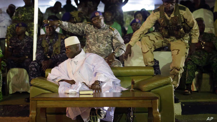Gambian officers signal to the media not to block the public's view during President Yahya Jammeh's final rally in Banjul, Gambia, Tuesday Nov. 29, 2016. Gambia's opposition parties are rallying together behind a single candidate for the first time i