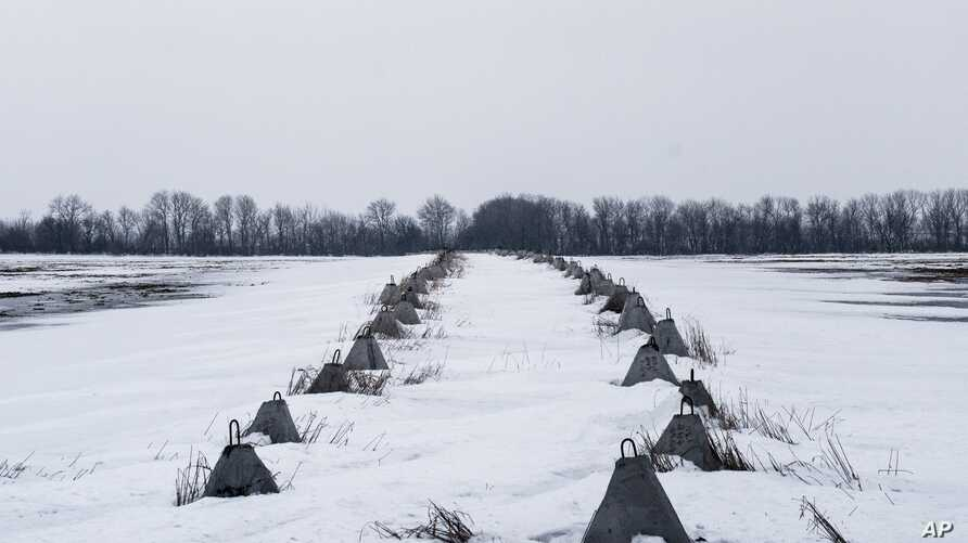 FILE - A concrete anti-tank line is seen on a field near Avdiivka, Donetsk region, eastern Ukraine, Feb. 5, 2017.