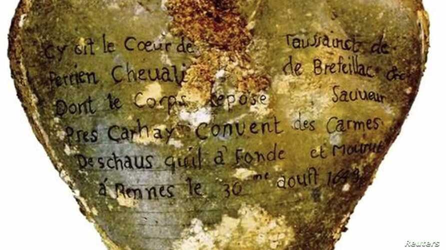 A heart-shaped lead urn with an inscription identifying the contents as the heart of Toussaint Perrien, Knight of Brefeillac, found during excavation of the ruins of the medieval Jacobins convent in Rennes, France is shown in this handout photo provi