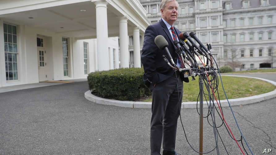 Republican Sen. Lindsey Graham speaks to members of the media outside the West Wing of the White House in Washington, after his meeting with President Donald Trump, Dec. 30, 2018.
