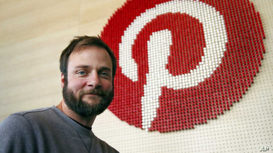 FILE - Pinterest co-founder and chief product officer, poses for a photo beside a wall of pegs symbolizing the company logo at Pinterest headquarters in San Francisco, Oct. 11, 2018.