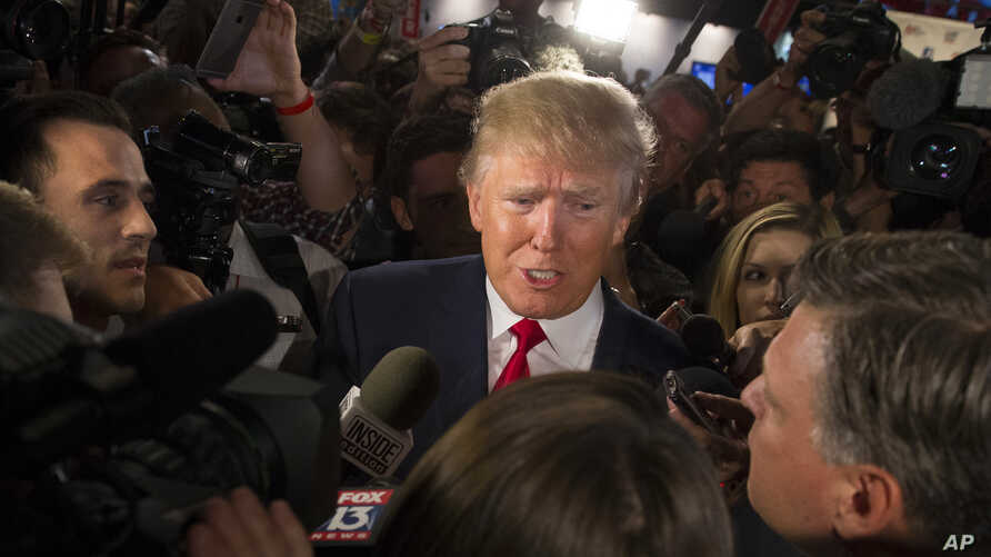 Republican presidential candidate Donald Trump speaks to the media in the spin room after the first Republican presidential debate at the Quicken Loans Arena, Aug. 6, 2015, in Cleveland.