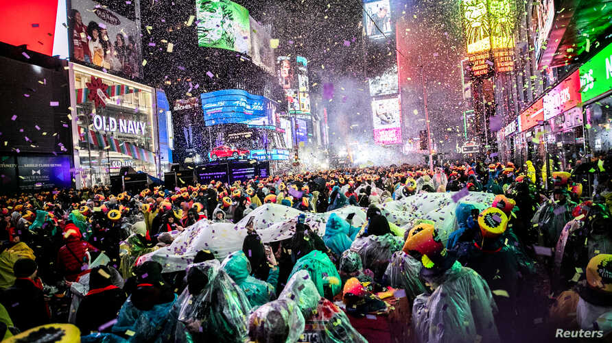 Revelers get ready to welcome the New Year in Times Square, New York, Dec. 31, 2018.
