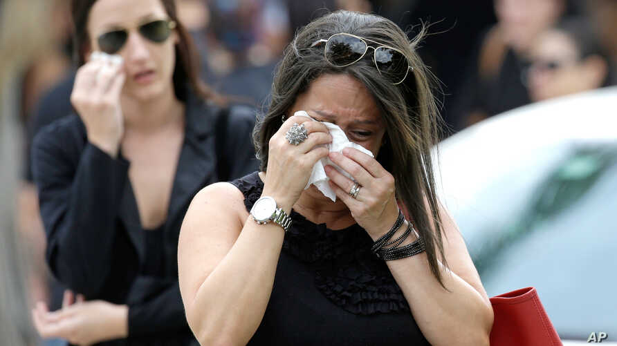 Mourners cry as they leave the funeral service for Anthony Luis Laureano Disla, one of the victims of the Pulse nightclub mass shooting, in Orlando, Florida, June 17, 2016.