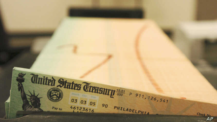 FILE - Trays of printed Social Security checks wait to be mailed from the U.S. Treasury's Financial Management services facility in Philadelphia.