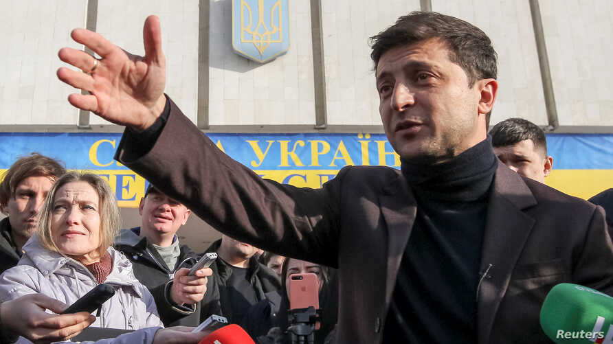FILE - Volodymyr Zelenskiy, a candidate in Ukraine's upcoming presidential elections who came to fame as TV comic, speaks after submitting registration documents to the Central Election Commission, in Kyiv, Ukraine, Jan. 25, 2019.