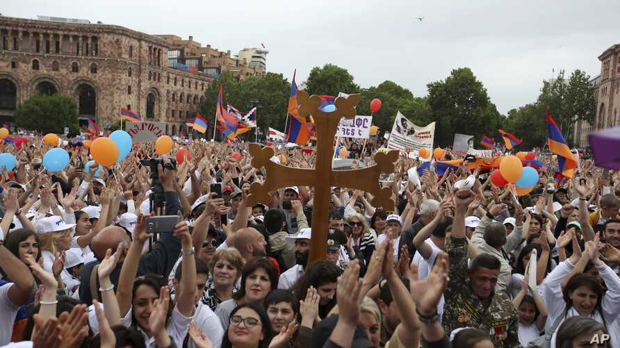 People cheer at the Republic Square in Yerevan, May 8, 2018.